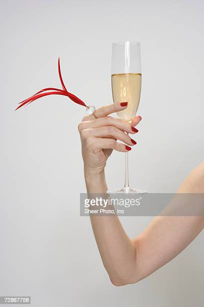 Mid adult woman holding glass of champagne