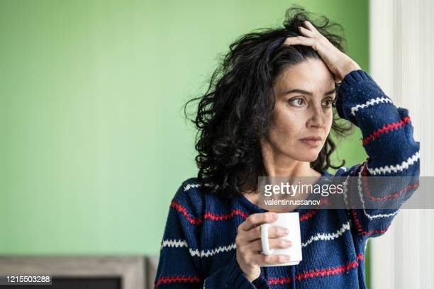mid adult woman in isolation at home during covid-19 - unemployment stock pictures, royalty-free photos & images