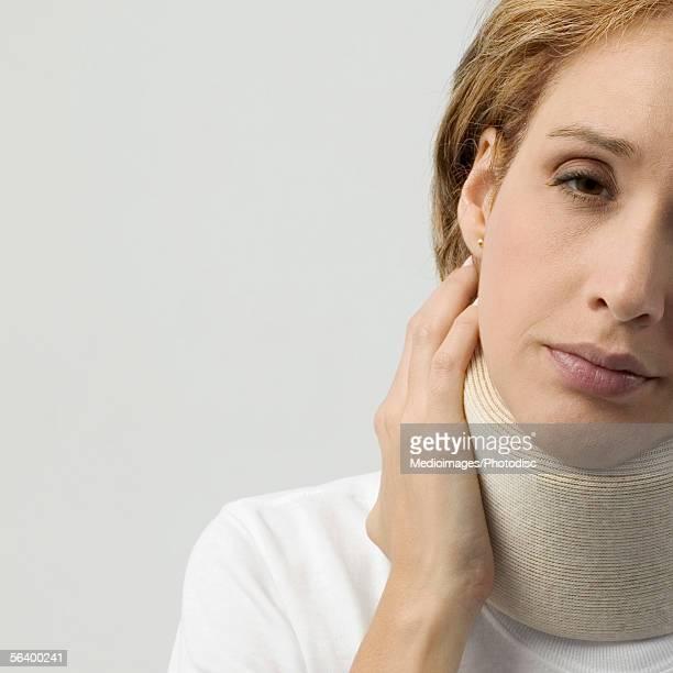 Mid adult woman in neck brace