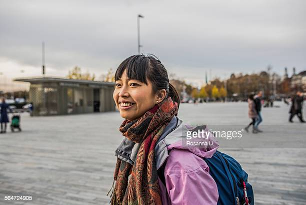 Mid adult woman in square, Zurich, Switzerland