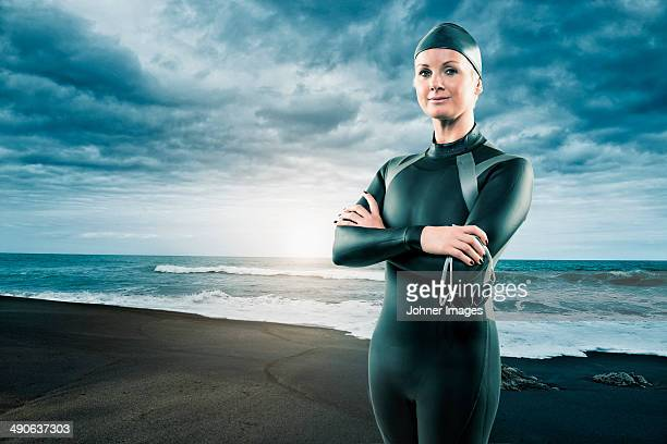 Mid adult woman in wetsuit at beach