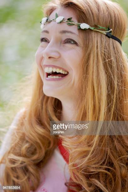 Mid adult woman laughing