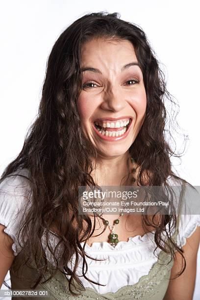 "mid adult woman laughing, portrait - ""compassionate eye"" stock-fotos und bilder"