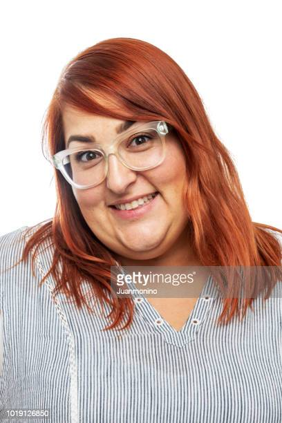 Mid adult woman looking at the camera on white background