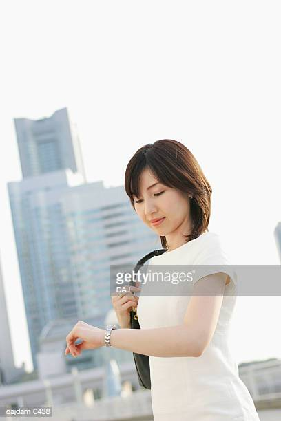 Mid Adult Woman Looking At Watch