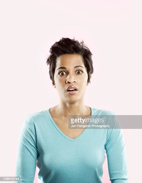 Mid adult woman looking shocked