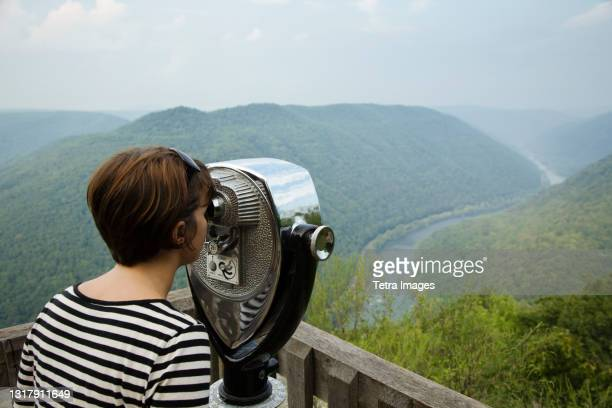 mid adult woman looking through coin operated binoculars,  rear view, new river gorge national river, fayetteville, west virginia, usa - fayetteville stock pictures, royalty-free photos & images