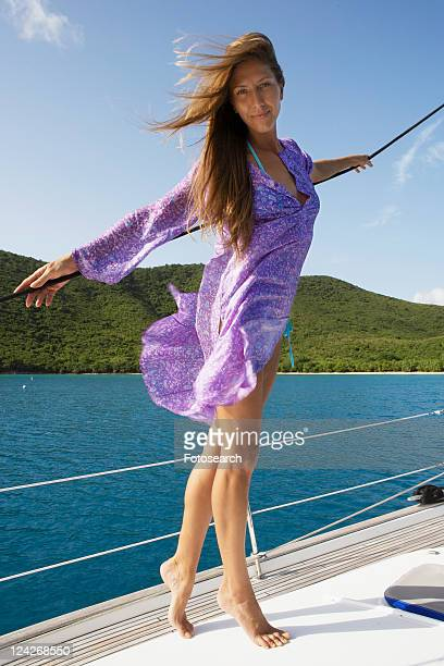 Mid adult woman posing on sailboat