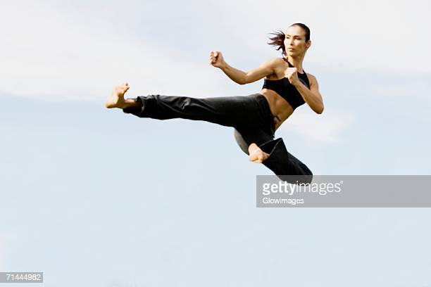 Mid adult woman practicing martial arts
