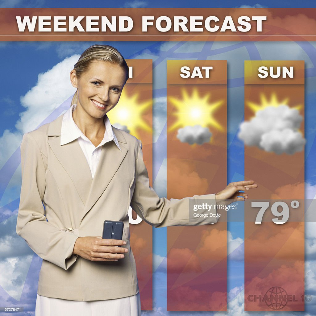 Mid adult woman presenting the weather forecast on tv : Stock Photo