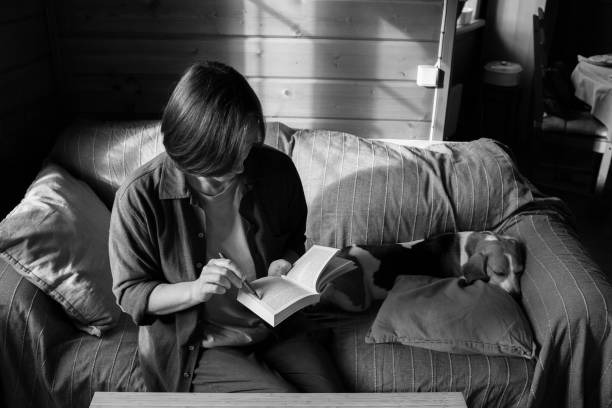 Mid adult woman reading book.
