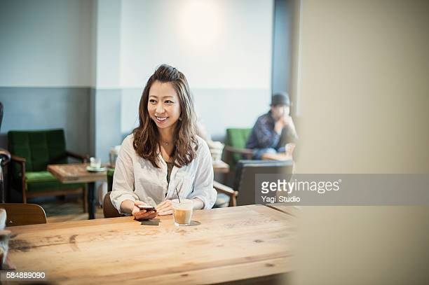 Mid adult woman relaxing in a cafe