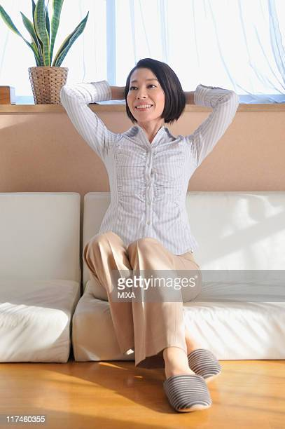 Mid adult woman relaxing on sofa