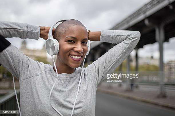 Mid adult woman runner listening to music doing sport