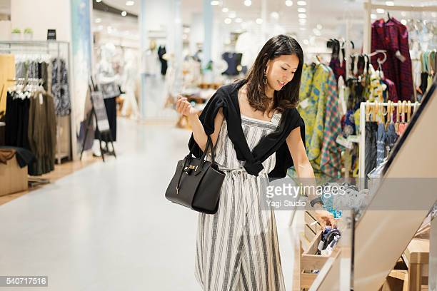 Mid adult woman shopping in shopping mall.