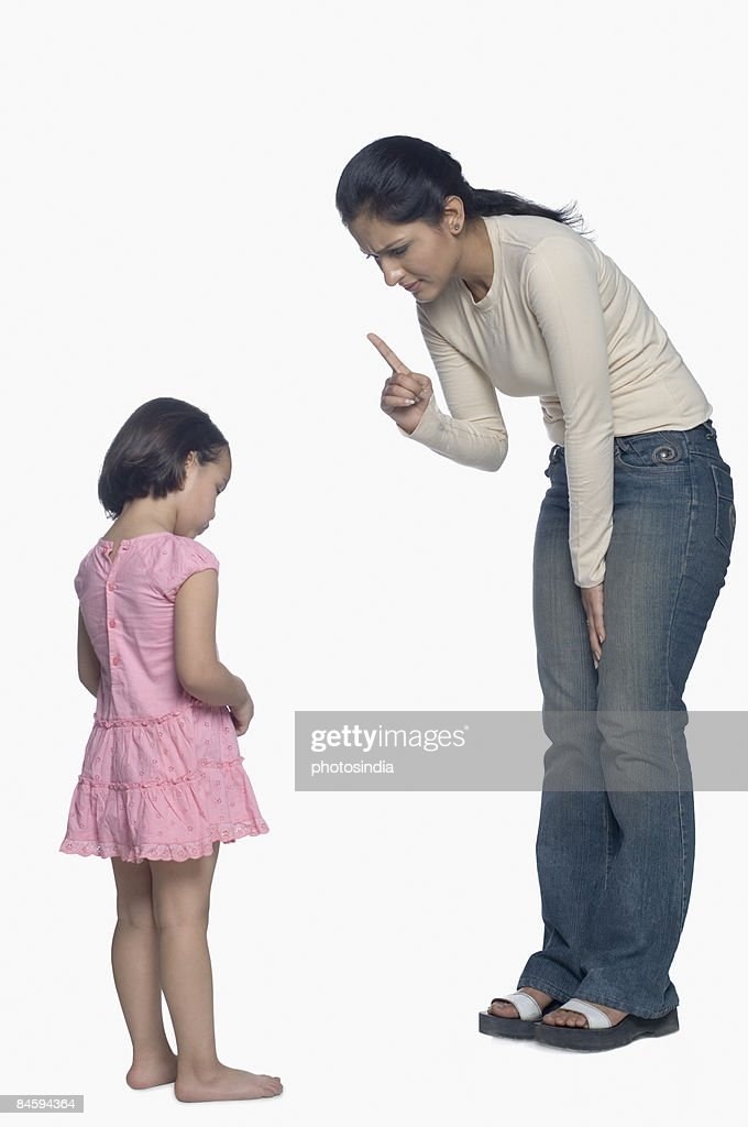 Mid adult woman shouting on her daughter : Stock-Foto