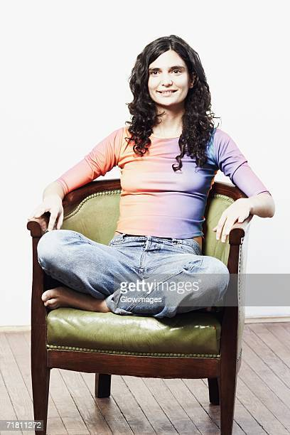 Mid adult woman sitting in an armchair