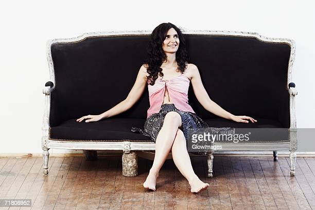 Mid adult woman sitting on a couch