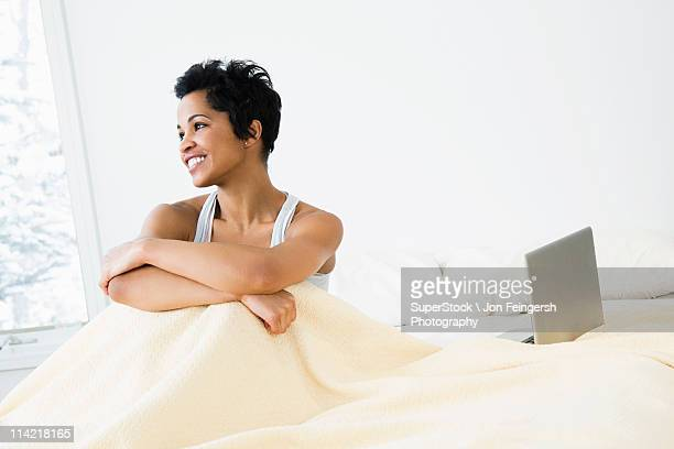 Mid adult woman sitting on the bed