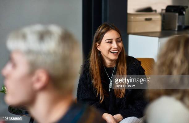 mid adult woman smiling and laughing - cheerful stock pictures, royalty-free photos & images