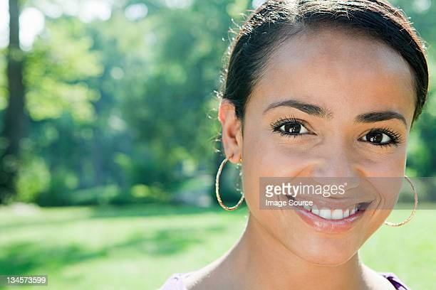 mid adult woman smiling, portrait - hoop earring stock pictures, royalty-free photos & images