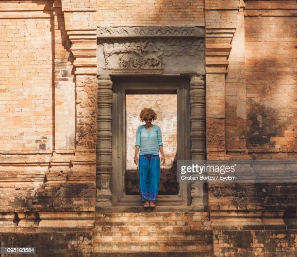 mid adult woman standing in historic building - bortes stock pictures, royalty-free photos & images