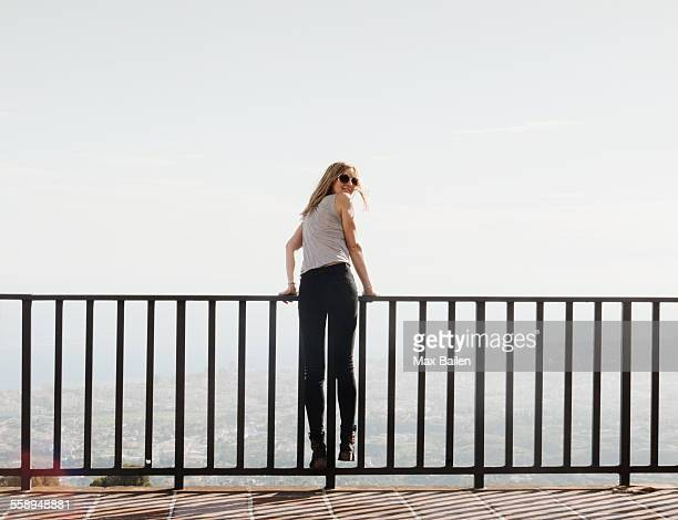 mid adult woman standing on balcony, looking at view, mijas, andalucia, spain - railing stock pictures, royalty-free photos & images