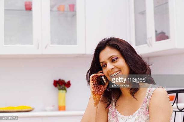 Mid adult woman talking on a mobile phone
