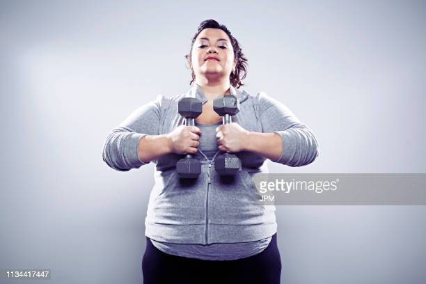 mid adult woman using hand weights - hand weight stock pictures, royalty-free photos & images