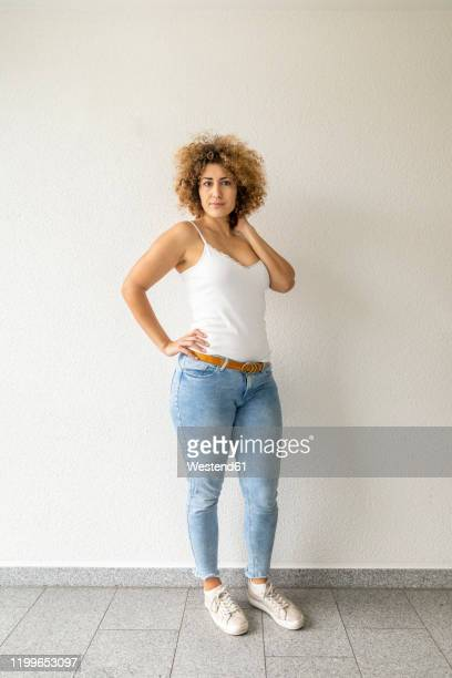 mid adult woman wearing jeans - voluptuous stock pictures, royalty-free photos & images