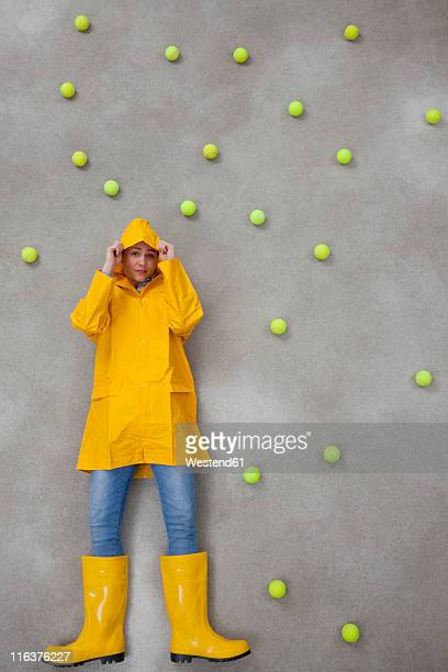 mid adult woman wearing rain coat and rubber boots in acid rain - acid rain stock photos and pictures