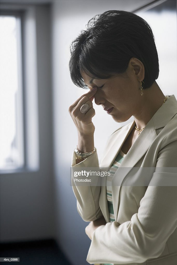Mid adult woman with a headache : Foto de stock