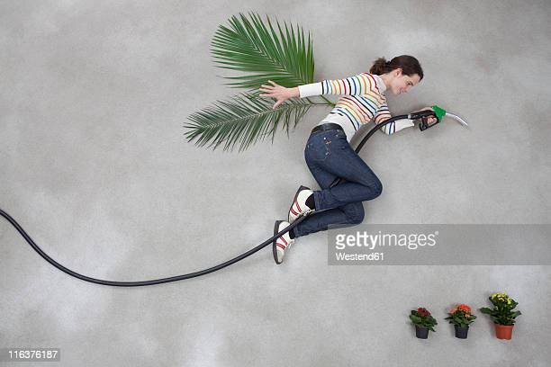 Mid adult woman with industrial hose