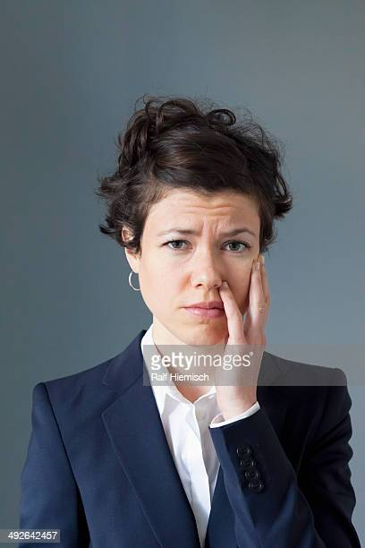 Mid adult woman with worried expression, close-up