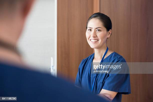 Mid adult woman working in hospital smiling