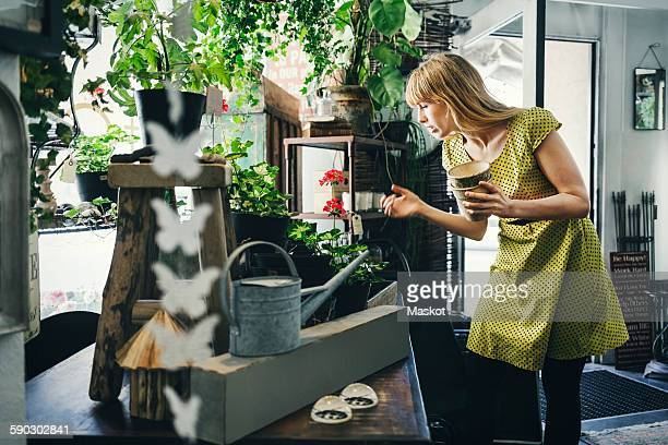 Mid adult woman working in interior design shop