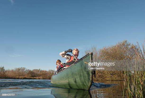 Mid adult women canoeing on river