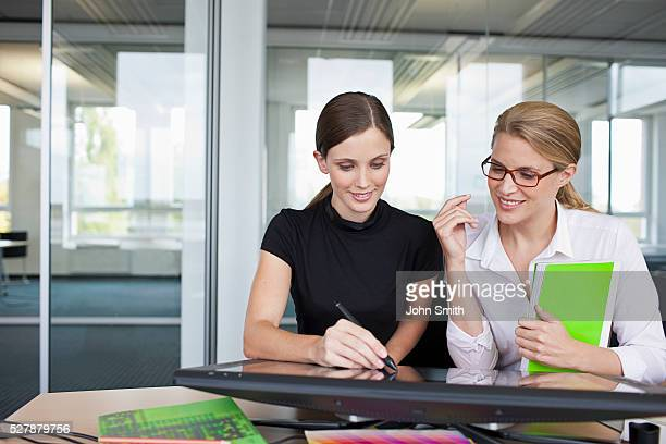 Mid adult women sitting in office