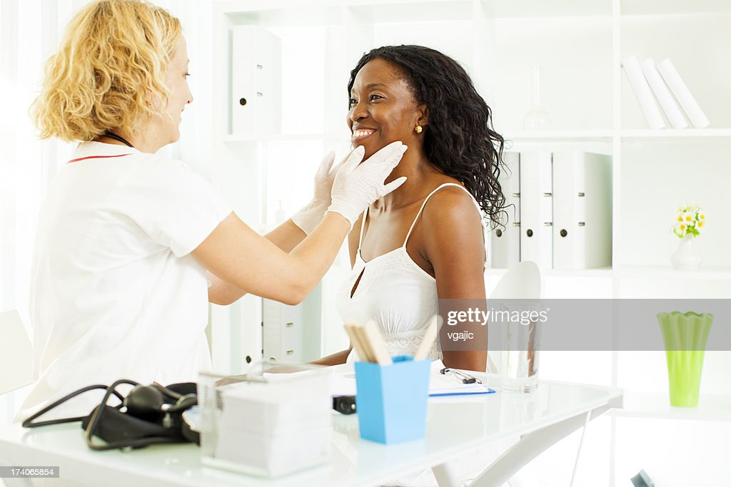 Mid Age African Woman Visit Doctor. : Stock Photo