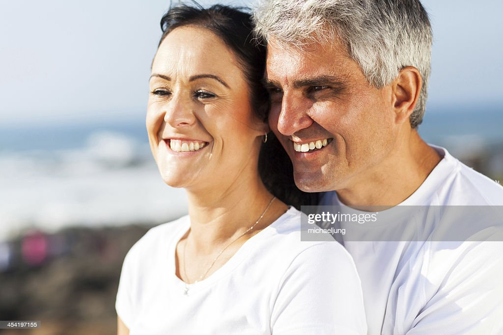 mid age husband and wife hugging : Stock Photo