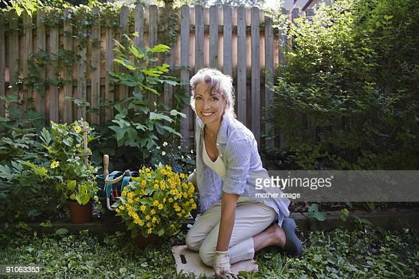 Mid age woman gardening in yard