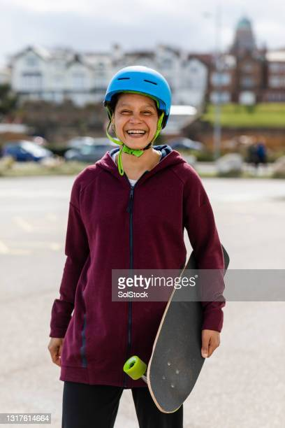mid age woman skateboarder - menopossibilities stock pictures, royalty-free photos & images