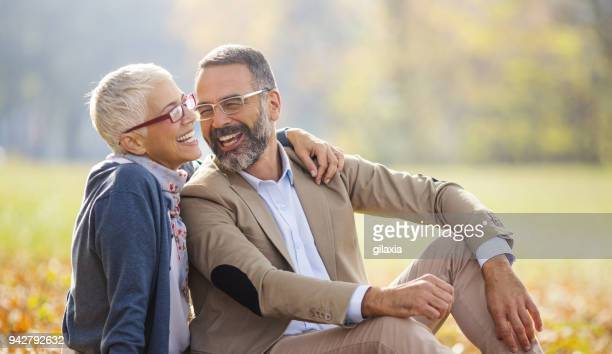 mid aged couple in a park - wife stock pictures, royalty-free photos & images