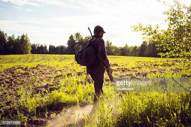 MId Aged Man Walking Through A Field In The Countryside