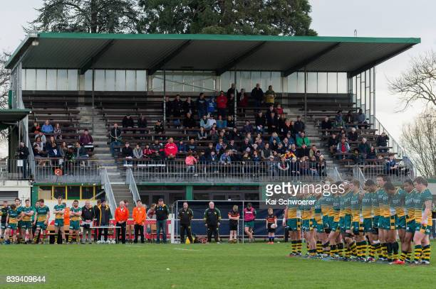 Mid Canterbury players observe a minute of silence in memory of former All Black Sir Colin Meads prior to the round one Heartland Championship match...
