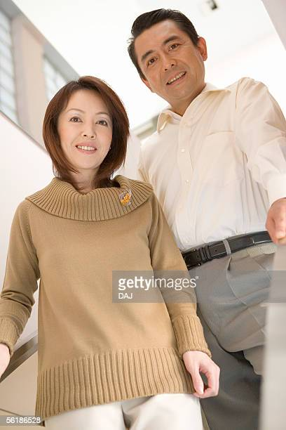 Mid couple standing, smiling, portrait
