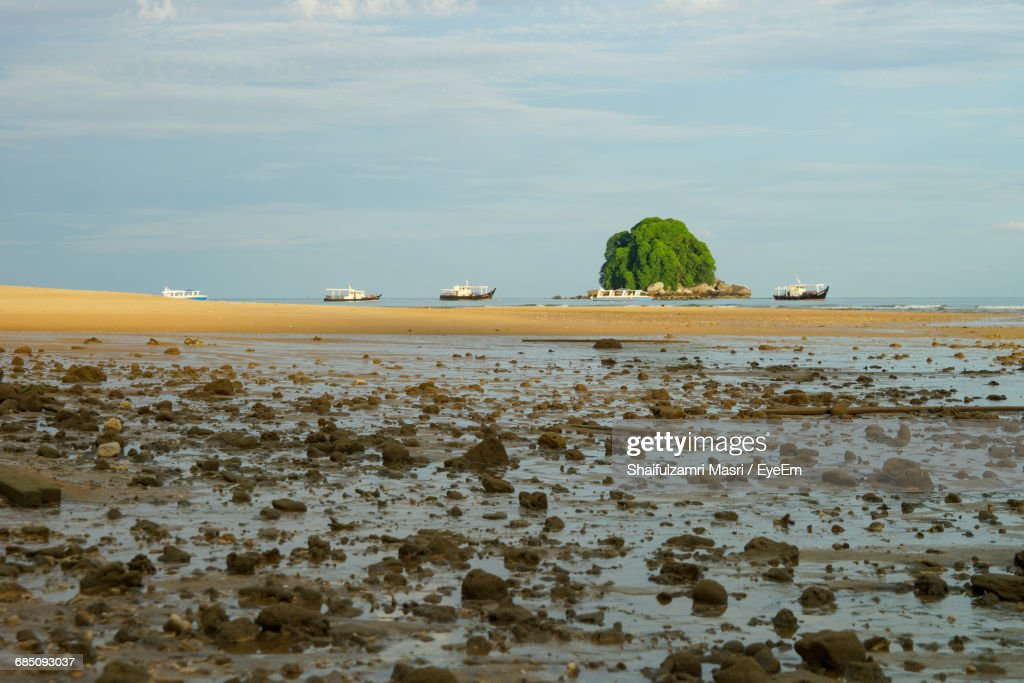 Mid Distance Of Boats Moored In Calm Sea : Stock Photo