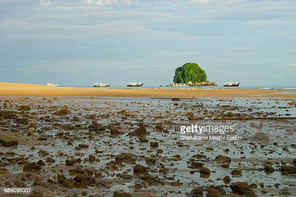 mid distance of boats moored in calm sea - shaifulzamri stock pictures, royalty-free photos & images