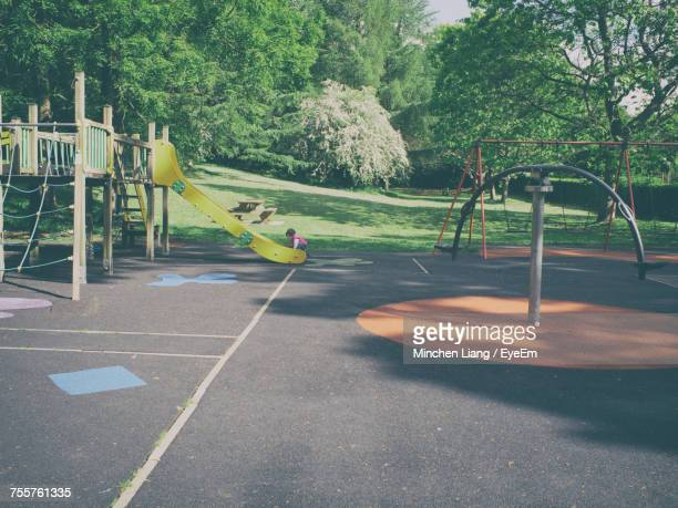 Mid Distance View Of Girl Playing In Playground
