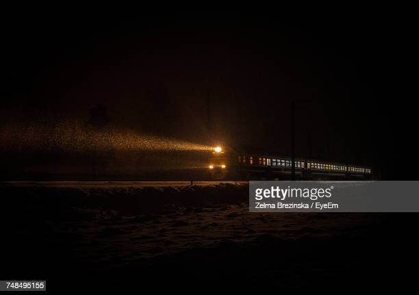 Mid Distance View Of Illuminated Train At Night